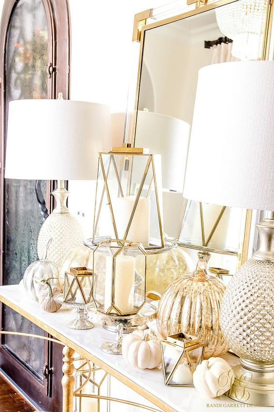 elegant white Thanksgiving decpr with pumpkins, gold candleholders with white candles and mercury glass pumpkins