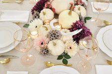 gold cutlery, gold rimmed glasses gold stemmed pumpkins for a modern refined Thanksgiving tablescape