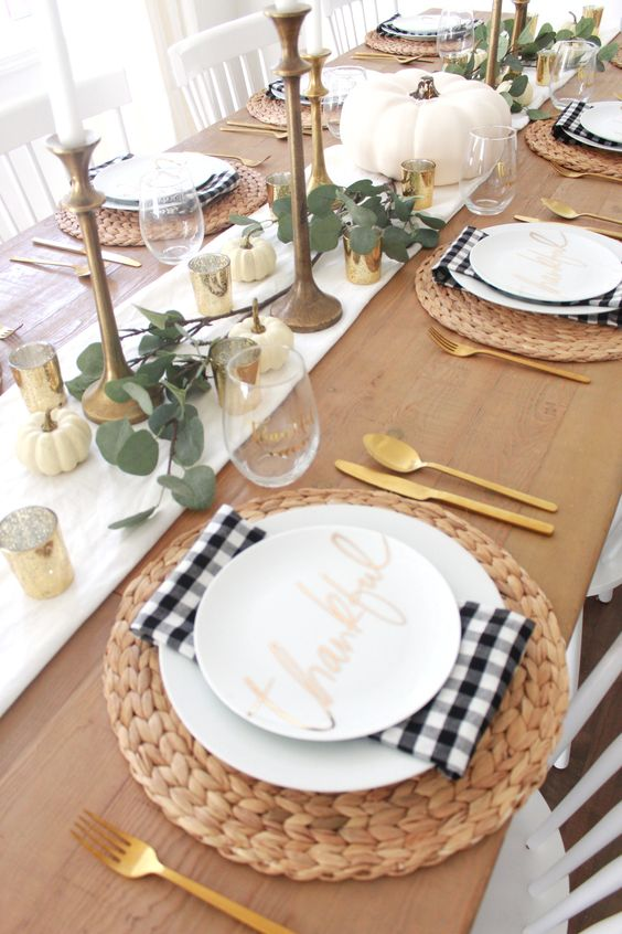 gold mercury glass candleholders, brass candleholders and gold cutlery for sprucing up the rustic tablescape