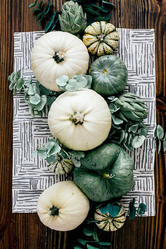 green and white pumpkins, greenery and artichokes for a lovely rustic Thanksgiving centerpiece