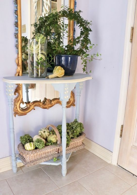 green rustic decor - a wreath growing and a basket with gourds and greenery will be a nice idea for fall and Thanksgiving
