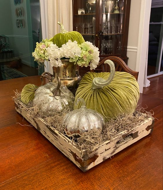 green velvet pumpkins and mercury glass ones in a wooden tray with hay for a lovely Thanksgiving centerpiece