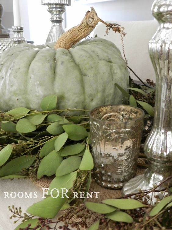 greenery, a green pumpkins and mercury glass candleholders for chic vintage and rustic Thanksgiving decor