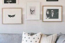minimalist Halloween decor – a gallery wall of black and white scary pics that is amazing for non-tacky styling