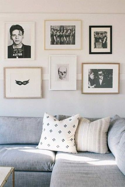 minimalist Halloween decor - a gallery wall of black and white scary pics that is amazing for non-tacky styling