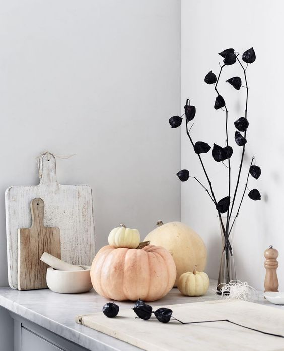 minimalist Halloween decor with black dried blooms on branches, neutral pumpkins is easy and very fresh and cool