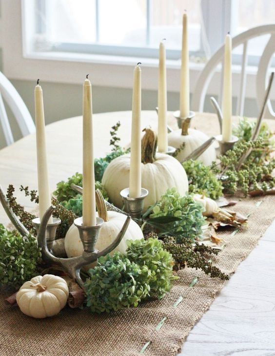 rustic Thanksgiving decor with hydrangeas, antlers, candles and white pumpkins is very pretty and chic