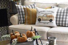rustic vintage Thanksgiving decor of metal buckets, cotton, orange velvet pumpkins and greenery