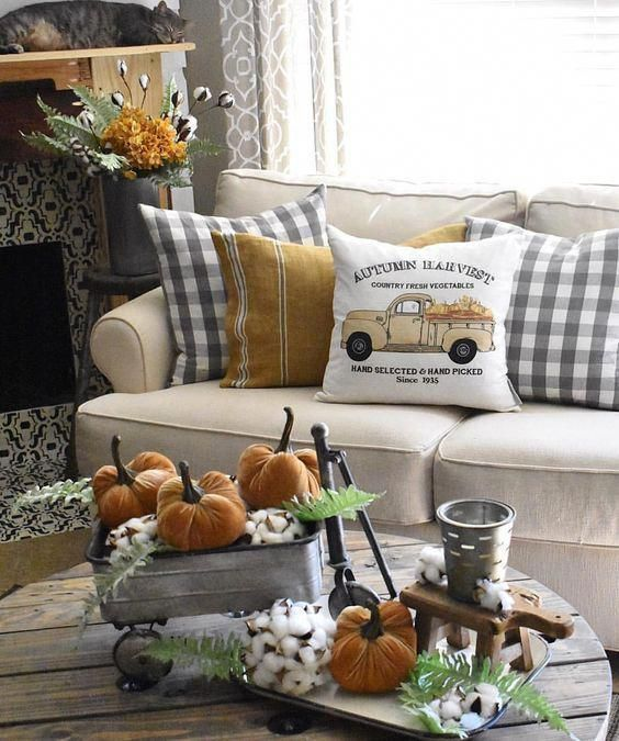 rustic vintage Thanksgiving decor of metal buckets, cotton, orange velvet pumpkins and greenery