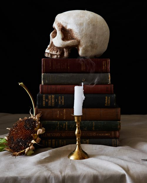 simple and elegant vintage Halloween decor with a stack of vintage books and a skull on top is amazing for your party