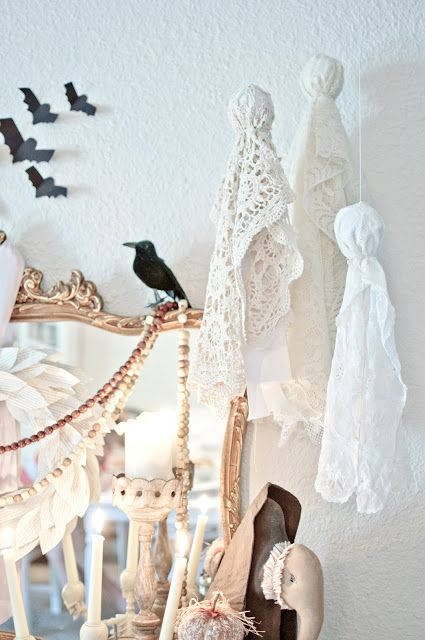 simple white ghosts of fabric and doilies are very easy to make and will give a slight vintage feel to your Halloween decor