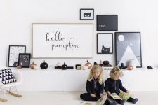a modern b&w gallery wall decorated for halloween
