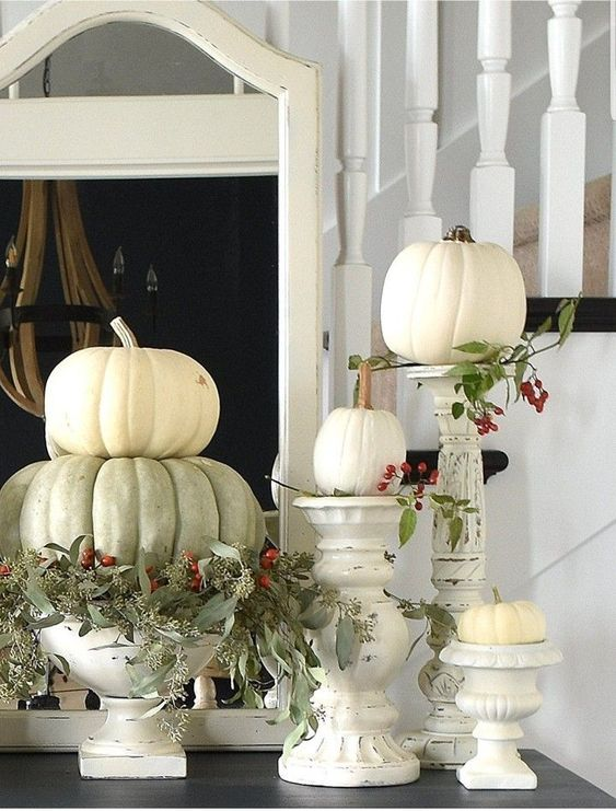 white and green pumpkins, greenery and berries, white shabby chic candleholders and stands