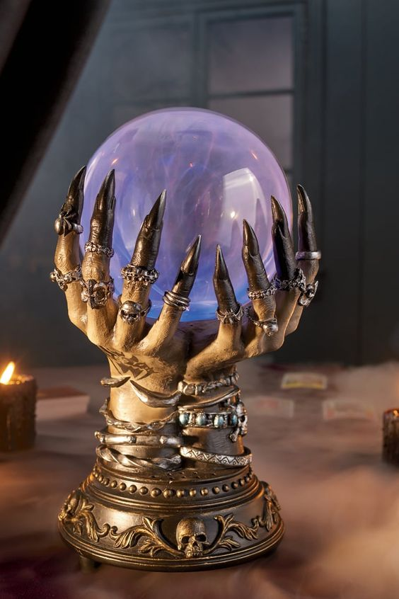 witch's hands with lots of jewelry holding a magical ball that will tell the future is a great idea for Halloween