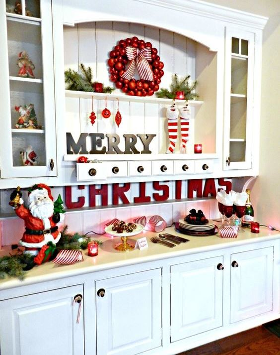 Santas, red letters, ornaments, evergreens, stockings, lights and candles for Christmas decor