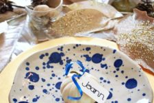 a blue and white polka dot plate is a fresh and bold touch to your modern Thanksgiving table