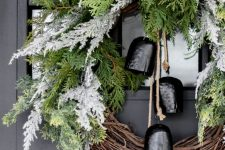 a simple and stylirsh rustic christmas wreath for a front door