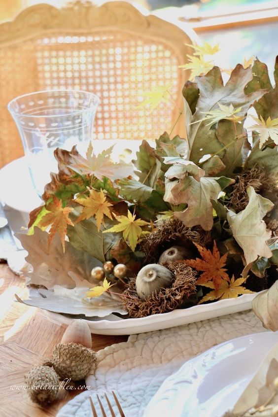a lovely all-natural Thanksgiving centerpiece of fall leaves, acorns, fruits and other stuff can be made last minute