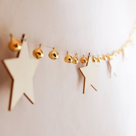 a lovely garland of plywood stars and gold bells is ideal for Christmas, add a shiny touch with them