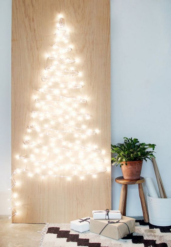 a minimalist Christmas sign with lights that form a Christmas tree is a stylish idea that can be easily DIYed