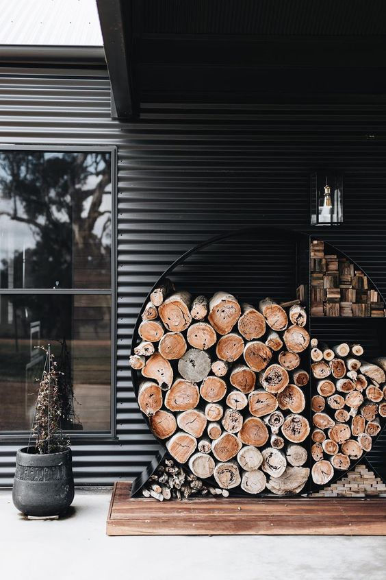 a minimalist firewood storage shaped as a circle is a great idea for both indoors and outdoors