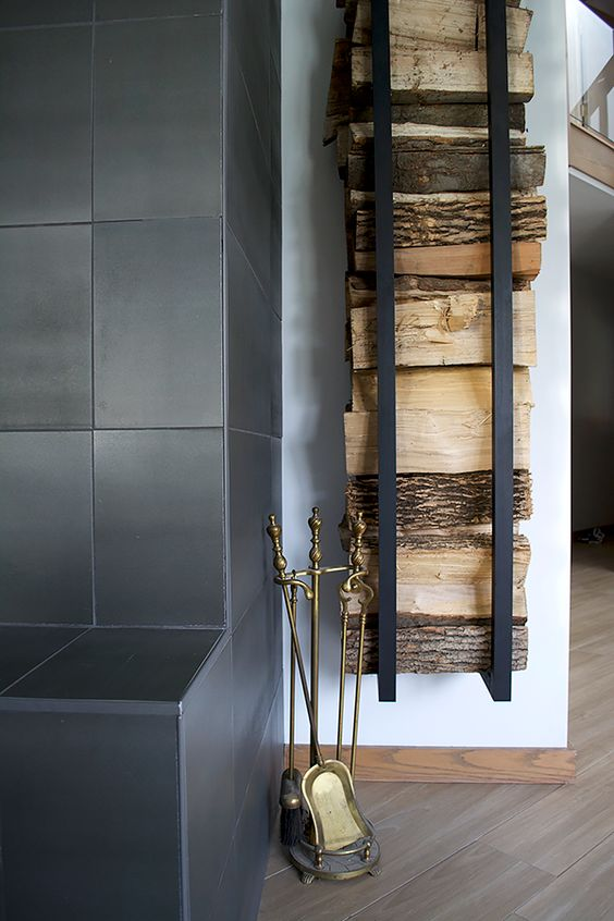 a modern and laconic wall-mounted firewood holder is a very stylish idea for a minimalist space and looks cool and chic