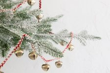 a red twine and mini copper bells can be used to decorate a Christmas tree or something else