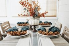 a simple and rustic tablescape done with teal plaid napkins and a striped runner that contrast the earthy tones here