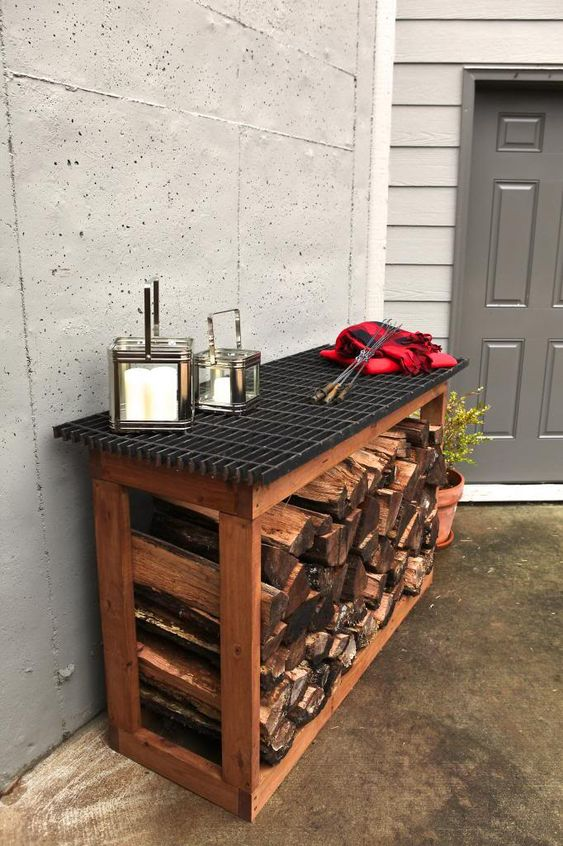 a simple console table with an open storage space that can be used for firewood is a nice idea for outdoors