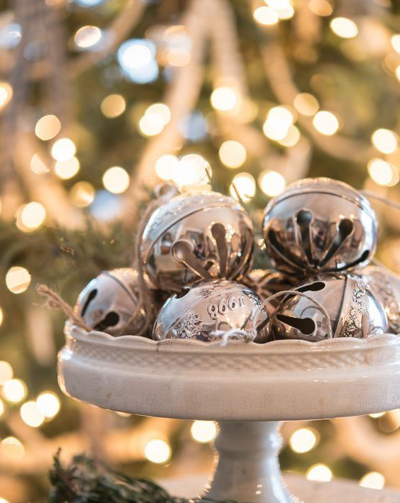 a vintage white stand with vintage silver bells is a chic last-minute Christmas centerpiece or just decoration to rock