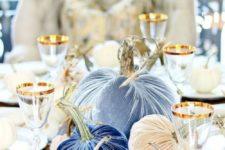 an arrangement of blue velvet pumpkins is a cool centerpiece idea that will last as long as you want