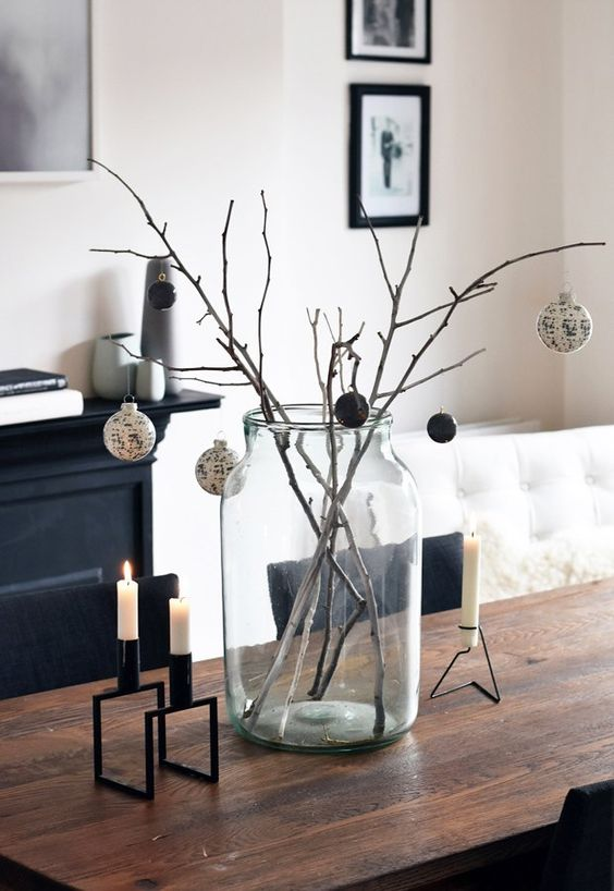 branches in a jar and black and white ornaments for a stylish arrangement, candles in black candleholders