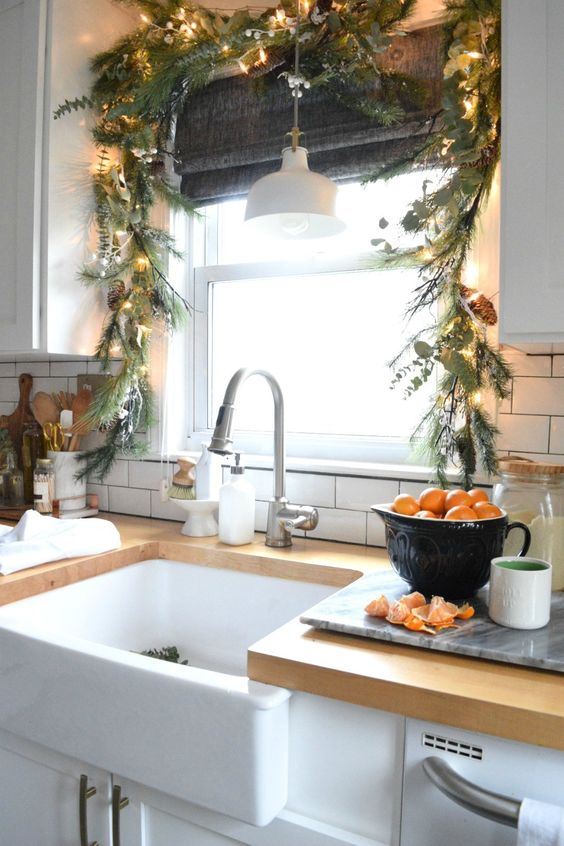 evergreens and greenery Christmas garland with pinecones and lights for decorating the kitchen