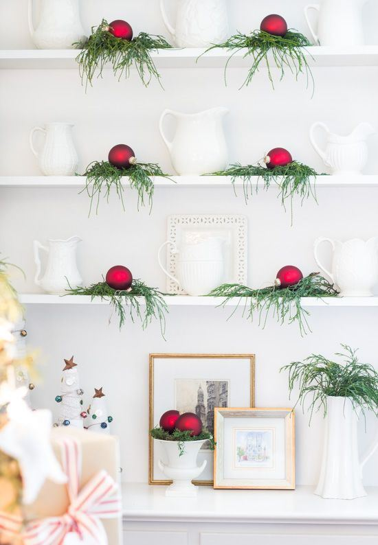 evergreens and red Christmas ornaments will bring a slight holiday feel to the space and make it Christmassy