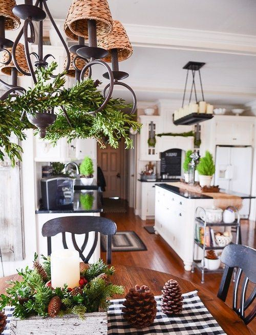 evergrens, pinecones and candles for a cozy farmhouse and rustic feel in the holiday kitchen