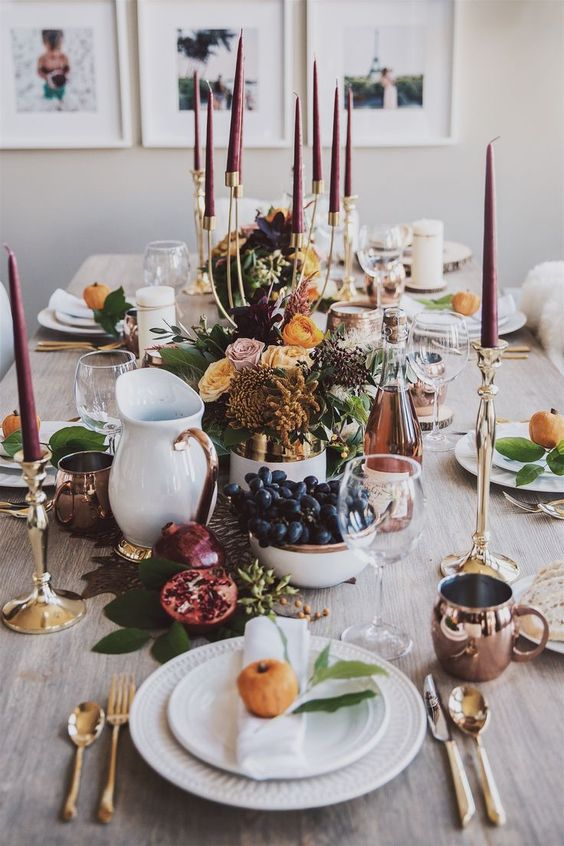 fruits, berries, leaves, bold blooms and burgundy candles for a modern natural Thanksgiving tablescape