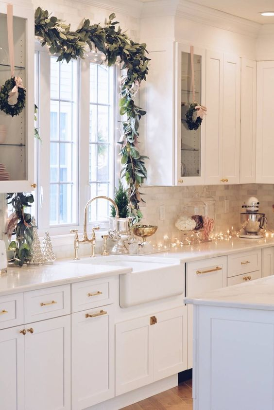 lights, pastel Christmas trees, evergreens, mini evergreen wreaths and touches of pink for pastel holiday decor