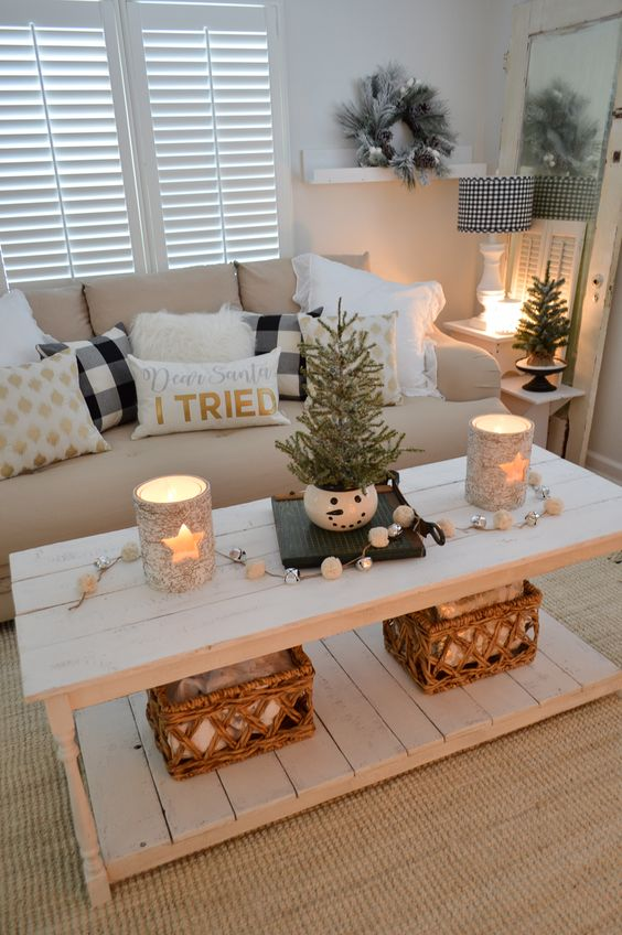 lovely holiday decor with star candleholders, white and silver bell garland, a couple of mini trees and a flocked Christmas wreath