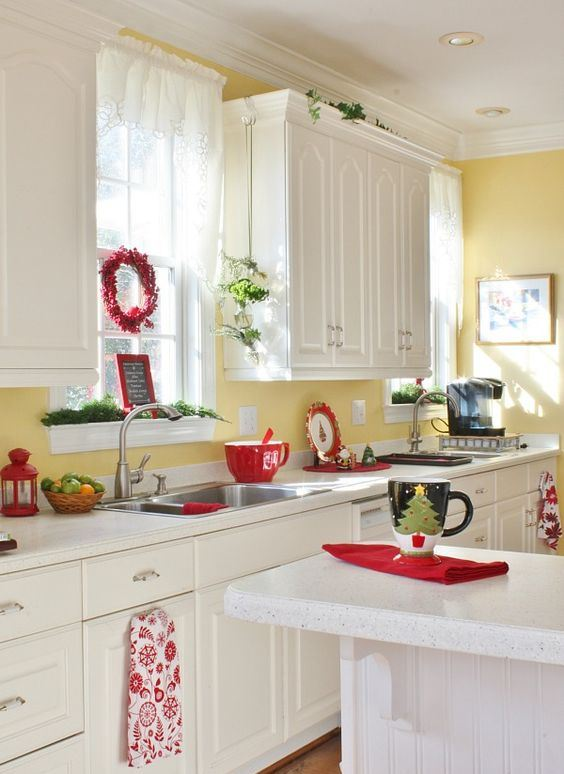 red cups, napkins, a berry wreath and evergreens for a light Christmas feel in the space