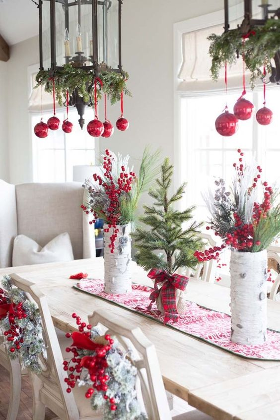 red ornaments, berries, evergreens, snowy Christmas wreaths and evergreens for natural holiday decor