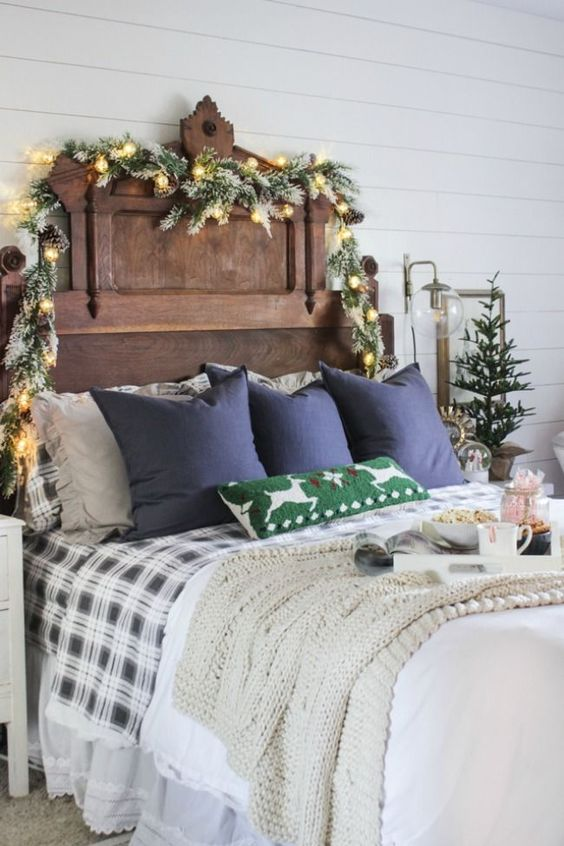 snowy evergreens, lights and pinecones, a mini Christmas tree, plaid bedding and a knit blanket for a festive feel