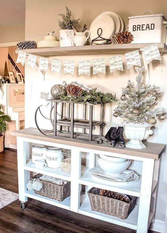 whitewashed evergreens, a frozen Christmas tree with metallic ornaments, pinecones and a cute bunting for a holiday look
