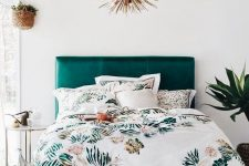 a bold teal leather mid-century modern bed with gold legs is a bright touch to your space