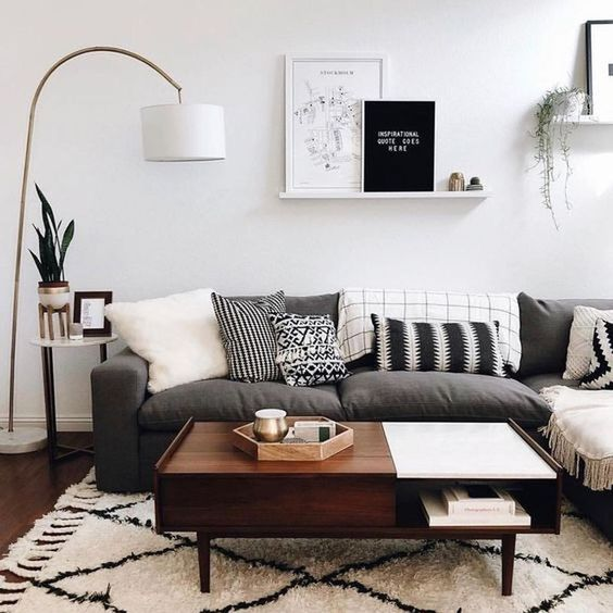 a color block mid-century modern coffee table, dark stained but with a white accent, with a closed and open storage compartment
