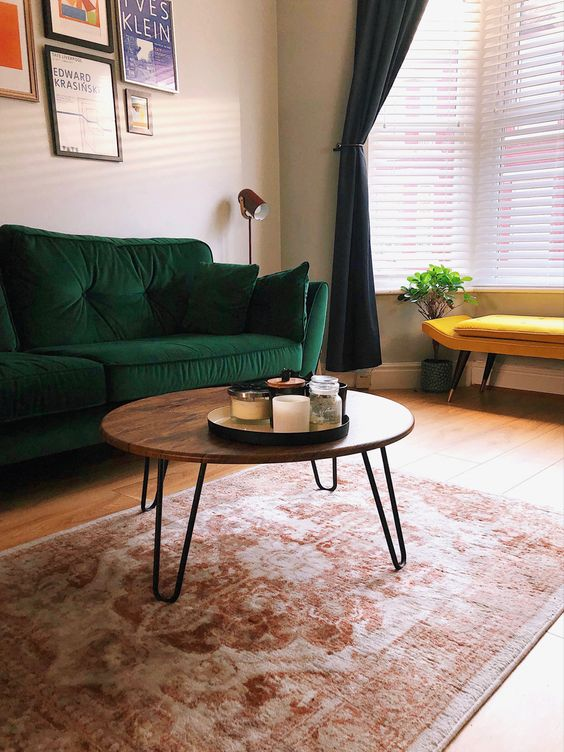 a cool mid-century modern coffee table with a rich stained round tabletop and hairpin legs is pure elegance and timeless style for your living room