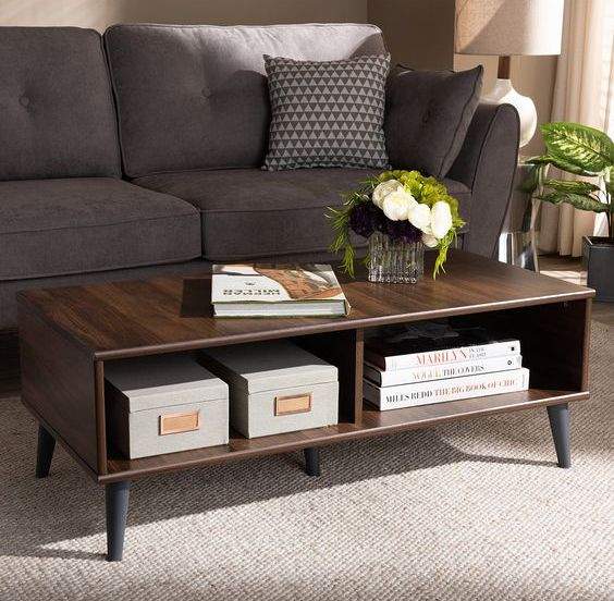 a dark-stained storage coffee table on black tapered legs is a cool and chic idea for a mid-century modern interior to rock