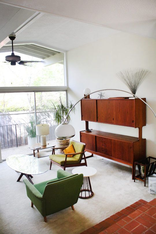 a fully closed mid-century modern storage unit features a couple of shelves - the tops of the storage compartments