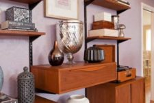 a large mid-century modern wall unit with closed compartments, a drawer and asymmetrically placed open shelves