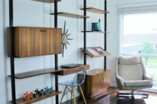 a large yet airy mid-century modern unit with closed compartments, shelves and slanted shelves all placed asymmetrically
