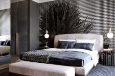 a light leather upholstered bed and a matching bench and striped nightstands for a bold touch